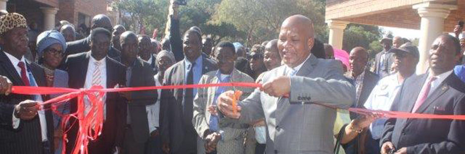 Caption for picture Premier Chupu Mathabatha during opening of Moletji Traditional Office, while Kgoshi Moloto III and other dignitaries looks on